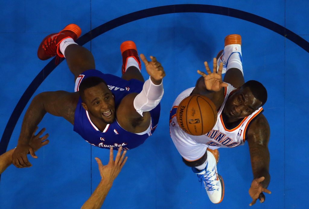 Glen Davis #0 of the Los Angeles Clippers jumps for a rebound against Kendrick Perkins #5 of the Oklahoma City Thunder in Game Five of the Western Conference Semifinals during the 2014 NBA Playoffs at Chesapeake Energy Arena on May 13, 2014 in Oklahoma City, Oklahoma.