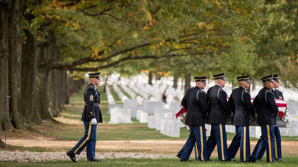 A casket team carries the remains of U.S. Army Cpl. Robert E. Meyers, a Korean War soldier, at Arlington National Cemetery in 2015. Meyers' remains were identified decades after his unit was involved in combat operations near Sonchu, North Korea.