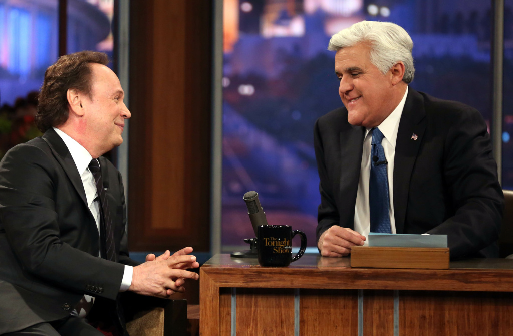"""Billy Crystal, left, talks to host Jay Leno during the final taping of  NBC's """"The Tonight Show with Jay Leno,"""