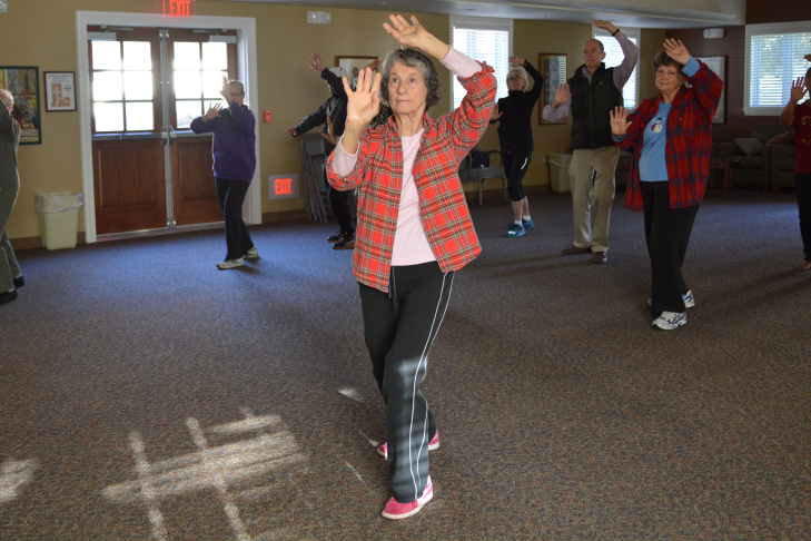 Angela Donnelly, 71, and other residents practice tai chi at Pilgrim Place on Nov. 1, 2013.