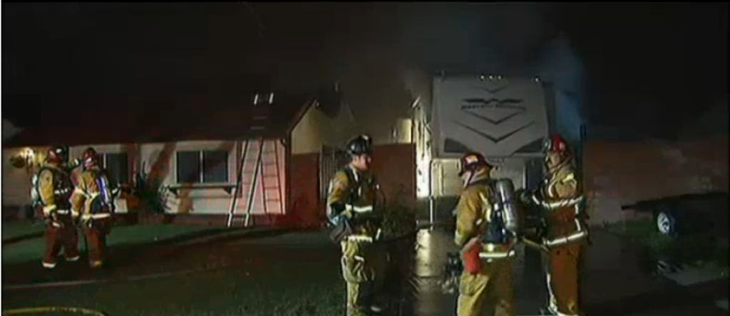 Firefighters work to extinguish flames near a home in Riverside County on February 28, 2013.