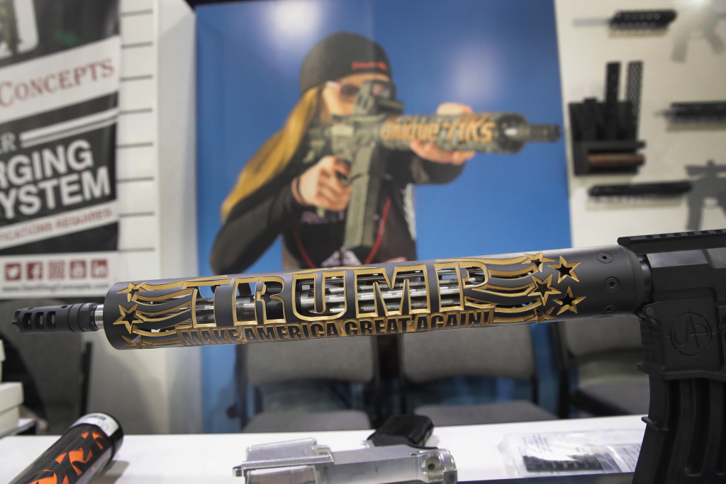An AR-15 with a custom handguard honoring President Donald Trump is displayed by Unique ARs at the 146th NRA Annual Meetings & Exhibits on April 29, 2017 in Atlanta, Georgia.