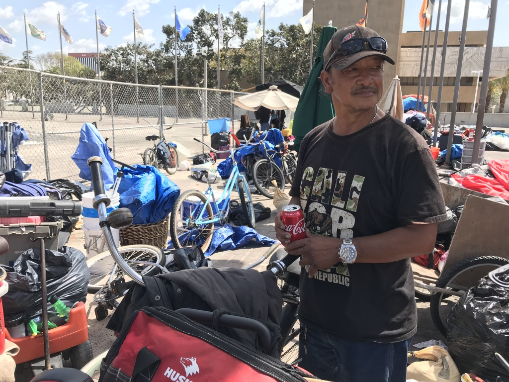Bernard, 59, gets ready to leave the Plaza of the Flags, where he lived in a tent for eight years, bound for a homeless shelter in Anaheim. April 12, 2018.