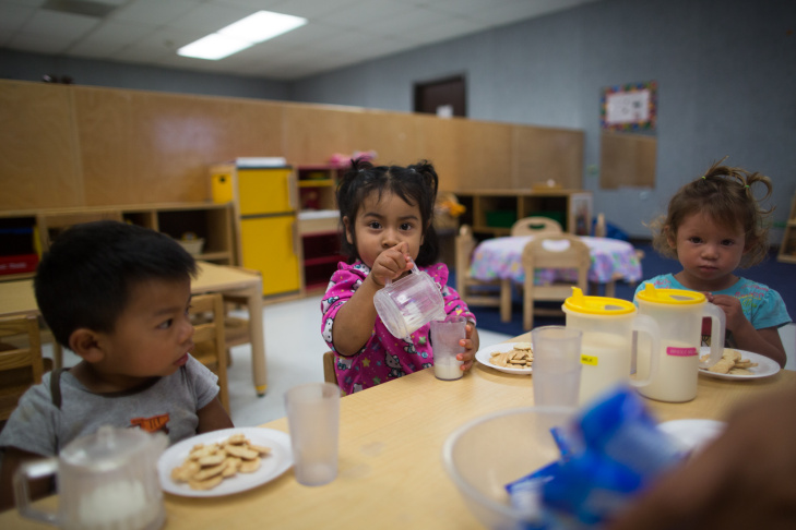 Aylyn Bautista pours milk for herself during snacktime after a nap at Encanto Migrant and Seasonal Headstart.