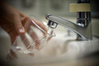 File: Water runs from a tap. Some Inland Empire residents have had funny smelling water recently.