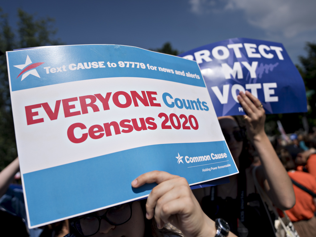 A demonstrator holds a sign about the U.S. census outside the Supreme Court in Washington, D.C., in 2019. The Census Bureau has stopped all work on President Trump's directive to produce a count of unauthorized immigrants that could be subtracted from a key set of census numbers, NPR has learned.