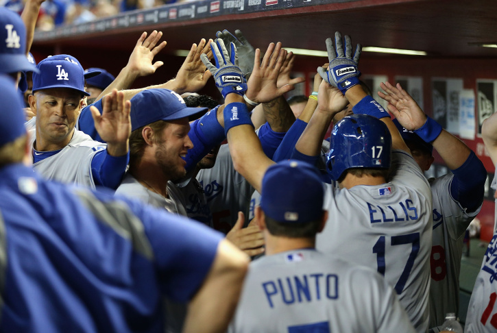 A.J. Ellis  #17 of the Los Angeles Dodgers high fives Michael Young #10 after hititng a solo home run against the Arizona Diamondbacks during the eighth inning of the MLB game at Chase Field on Sept. 19, 2013 in Phoenix, Arizona.