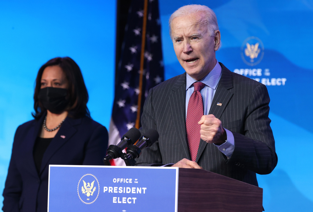 U.S. Vice President-elect Kamala Harris looks on as U.S. President-elect Joe Biden delivers remarks after he announced cabinet nominees that will round out his economic team, including secretaries of commerce and labor, at The Queen theater on January 08, 2021 in Wilmington, Delaware.