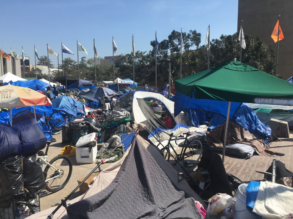 A homeless encampment in Santa Ana's Plaza of the Flags earlier this year. Dirty needles are among the issues as Orange County grapples with a growing homeless population.