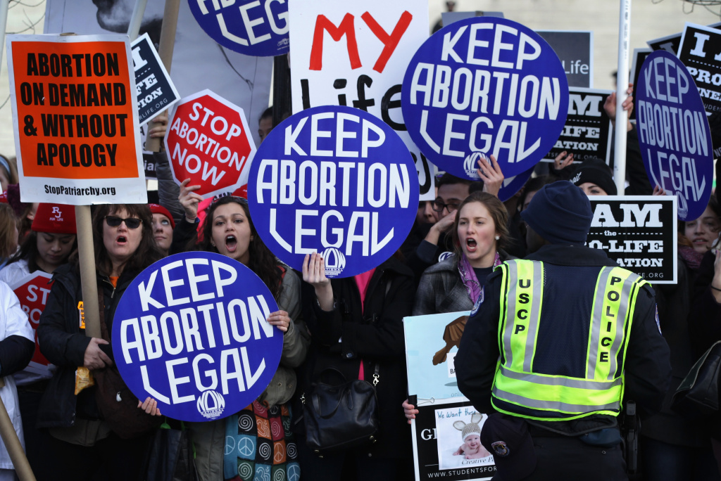 WASHINGTON, DC - JANUARY 22:  Pro-choice activists shout slogans before the annual March for Life passes by the U.S. Supreme Court January 22, 2015 in Washington, DC. Pro-life activists gathered in the nation's capital to mark the 1973 Supreme Court  Roe v. Wade decision that legalized abortion.  (Photo by Alex Wong/Getty Images)