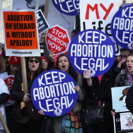 Pro-choice activists shout slogans before the annual March for Life passes by the U.S. Supreme Court January 22, 2015 in Washington, DC.
