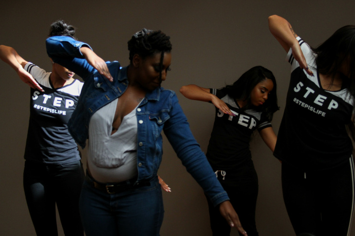 Members of the step team featured in Step, a documentary film, perform in the Mohn Broadacst Center, Los Angeles, California on July 28, 2017. Here their coach demonstrates some basic moves for learning how to step.