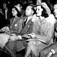 Rita Hayworth, Edward Judson, Doune McKay, and Gordon Oliver watching the Roller Derby at the Pan-Pacific Auditorium.