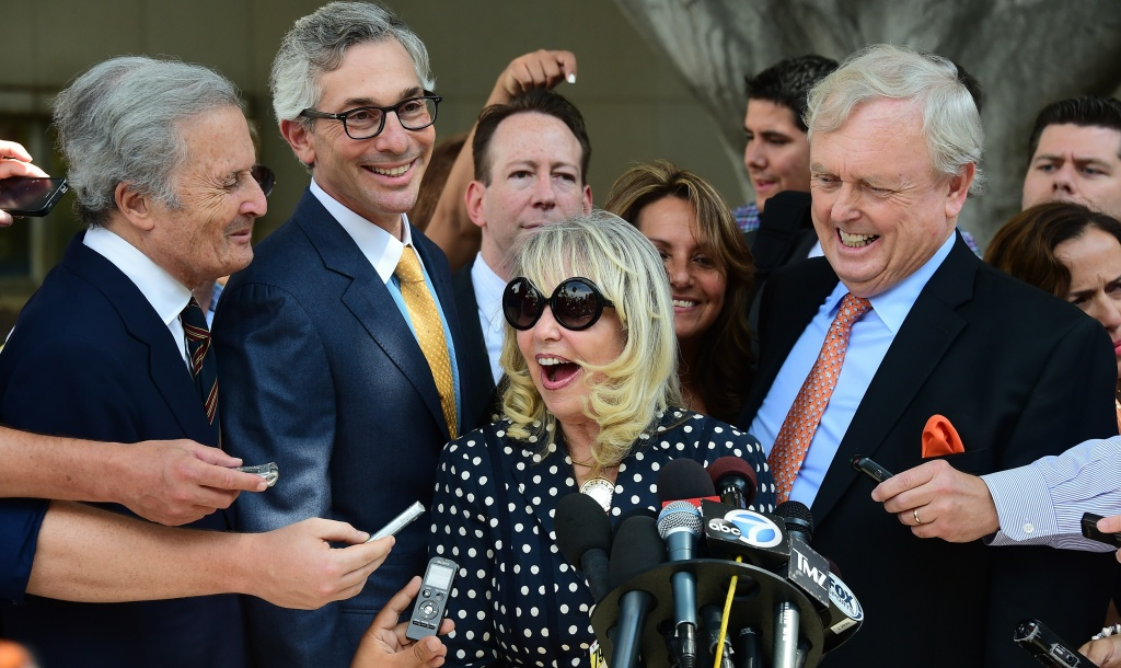 Shelly Sterling reacts while facing the media outside the courthouse in Los Angeles on July 28, 2014 after a ruling was made in the case between her and her husband Donald over the sale of the NBA's Los Angeles Clippers basketball team. A California judge gave the go-ahead to the $2 billion sale of the Los Angeles Clippers to former Microsoft chief executive Steve Ballmer, ruling that embattled owner Donald Sterling could not block the move.