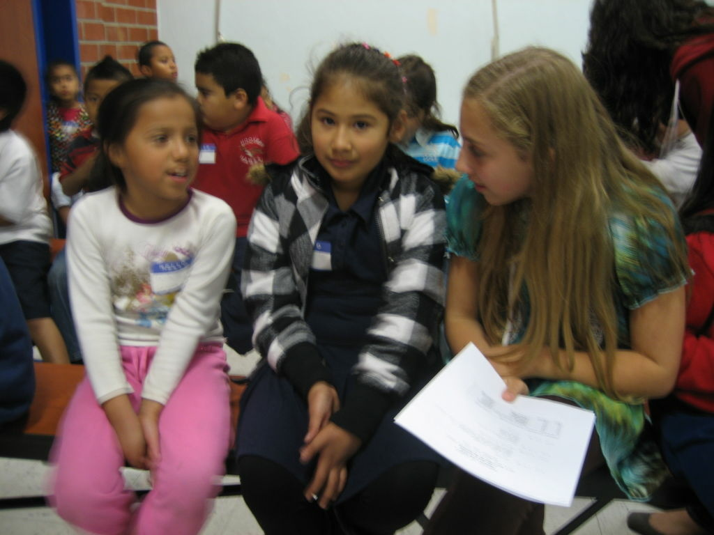 8th grader Nicole West, right, a student at Sinai Akiba Academy in West L.A. visits with second graders Melody Garcia, left, and Mercedes Torres both of Hoover Elementary near MacArthur Park.