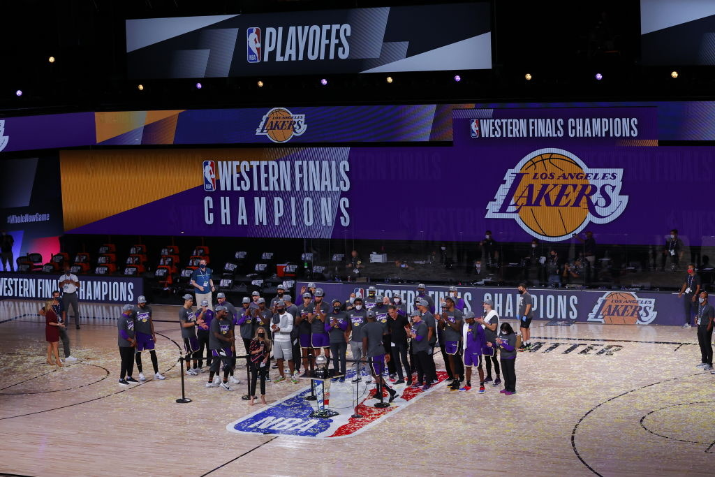 The Los Angeles Lakers celebrate their win and receive a trophy for Western Finals Champions against Denver Nuggets in Game Five of the Western Conference Finals.