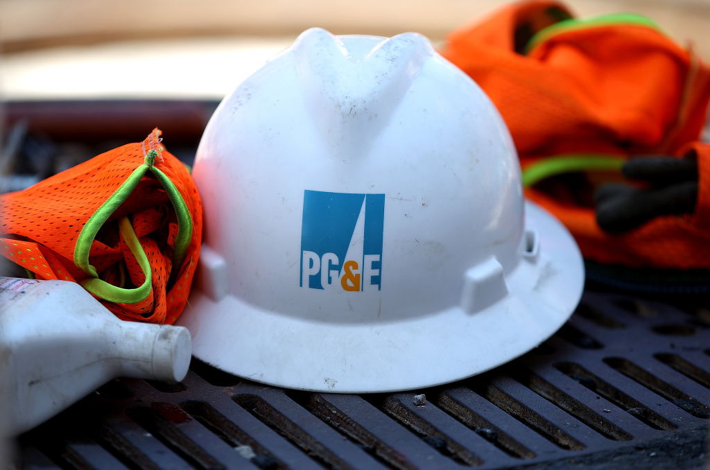 The Pacific Gas and Electric (PG&E) logo is displayed on a hard hat at a work site in this July 30, 2014 file photo taken in San Francisco, California. More than one-tenth of the largest wild population of threatened salmon in the Central Valley died after repair work near a power plant led PG&E to cut off a cooling flow of water into a creek, wildlife and utility officials said Friday, June 19, 2015.
