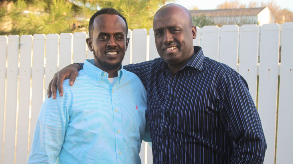 Jamal Batar and his father Aden at StoryCorps in West Valley City, Utah, in March 2017. The Batar family fled the civil war in Somalia for the United States in 1994.