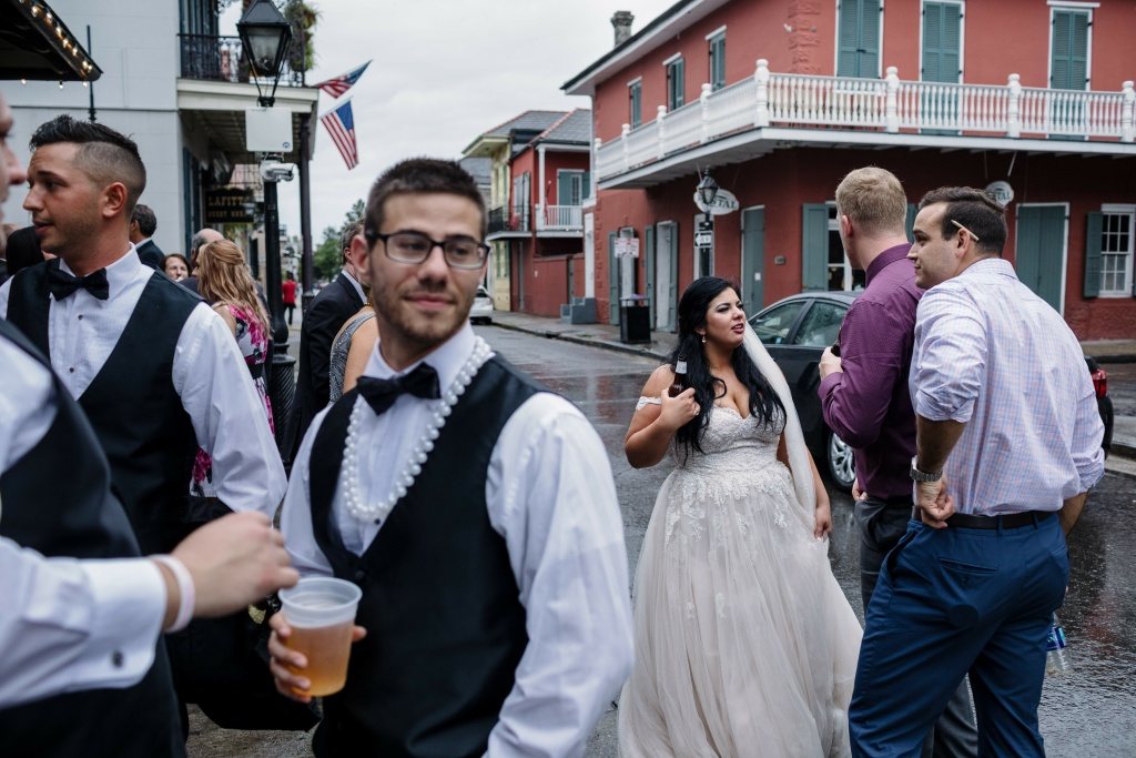 Newlywed Kaila Hager and her wedding party visit Lafitte's Blacksmith Bar in New Orleans on Saturday, October 7, 2017 as rain from Hurricane Nate pours down.