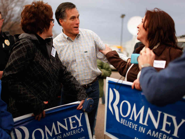 Republican presidential candidate Mitt Romney arrives onstage early Wednesday morning in Boston, moments before conceding defeat in the 2012 presidential election.