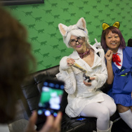 "Athena Stamos, left, dressed as Chemistry Cat, Linda Trujillo, dressed as Haru Yoshioka from ""The Cat Returns,"" and Kendra Guffey pose for a photo during the first-ever CatConLA at The Reef on Saturday, June 6, 2015."