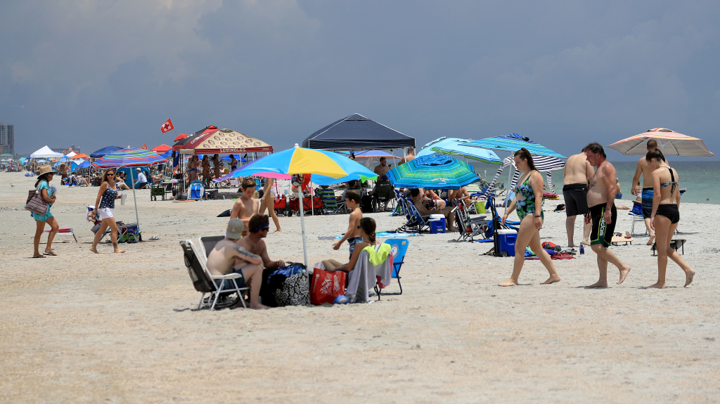 People visit Jacksonville Beach on Saturday in Jacksonville Beach, Florida. Coronavirus cases are spiking in states including Florida, Texas and Arizona.