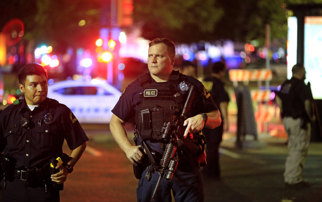 Dallas police stand watch near the scene where four Dallas police officers were shot and killed on July 7, 2016 in Dallas, Texas.