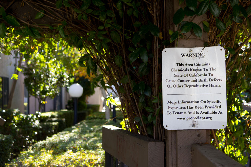 A sign posted at a Sacramento apartment complex warns of harmful chemicals on the premises, as required by Prop. 65.