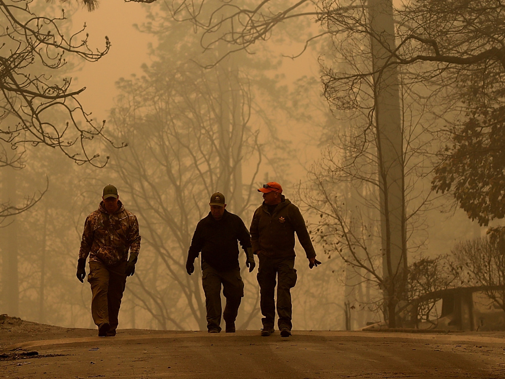 Sheriff deputies walk through a neighborhood destroyed by the Camp Fire near Paradise, Calif., on Nov. 10.