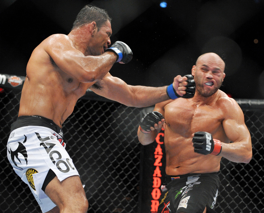 UFC fighter Antonio Nogueira (L) battles UFC fighter Randy Couture (R) during their Heavyweight bout at UFC 102:  Couture vs. Nogueira at the Rose Garden Arena on August 29, 2009 in Portland, Oregon.