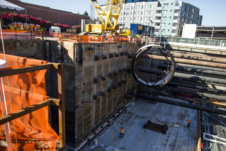 A segment of a tunnel boring machine is lowered into the Regional Connector Transit Project in Little Tokyo on Wednesday morning, Oct. 29, 2016. The project aims to reduce the need to transfer for riders and make rail trips to and through downtown Los Angeles faster and more convenient.