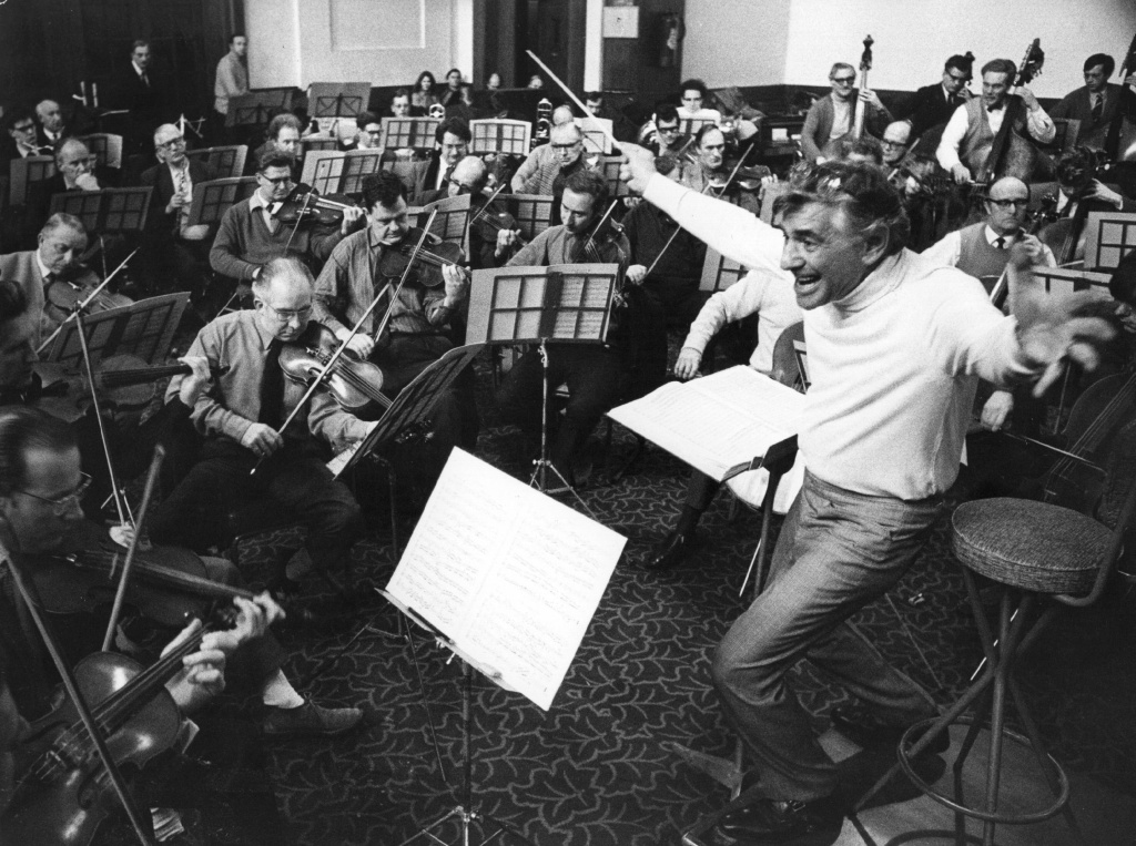 Conductor, composer and pianist Leonard Bernstein (1918 - 1990) conducts the London Symphony Orchestra in rehearsal at the St. Pancras Town Hall, London.