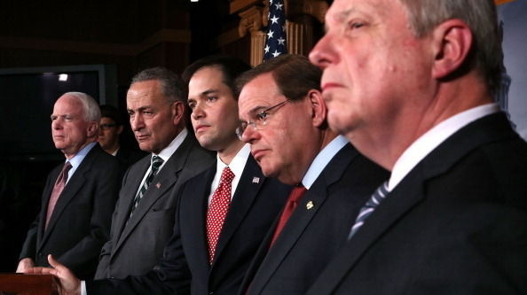 Sen. Charles Schumer, D-N.Y. and Sen. Marco Rubio, R-Fla., (second and third from left) announced plans to work on a bipartisan immigration proposal with their colleagues on Jan. 28 on Capitol Hill. They were also some of the first to respond to a leaked