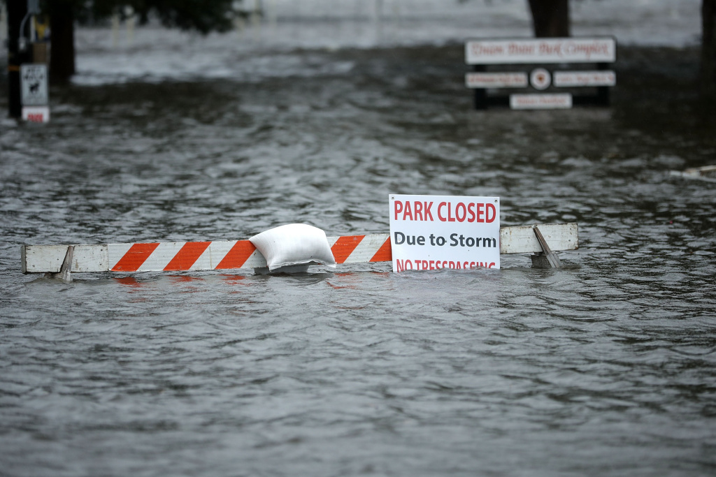 A sign warns people away from Union Point Park after is was flooded by the Neuse River during Hurricane Florence September 13, 2018 in New Bern, North Carolina.