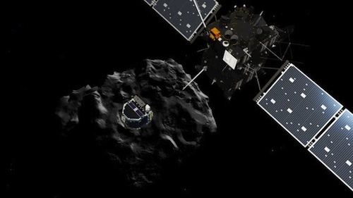 The Rosetta spacecraft, upper right, deploys a lander onto the surface of comet 67P, in background at center.