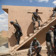 Iraqi security forces and allied Shiite militiamen look for Islamic State extremists in Tikrit on Tuesday. Iraqi forces were going house-to-house in search of snipers and booby traps.