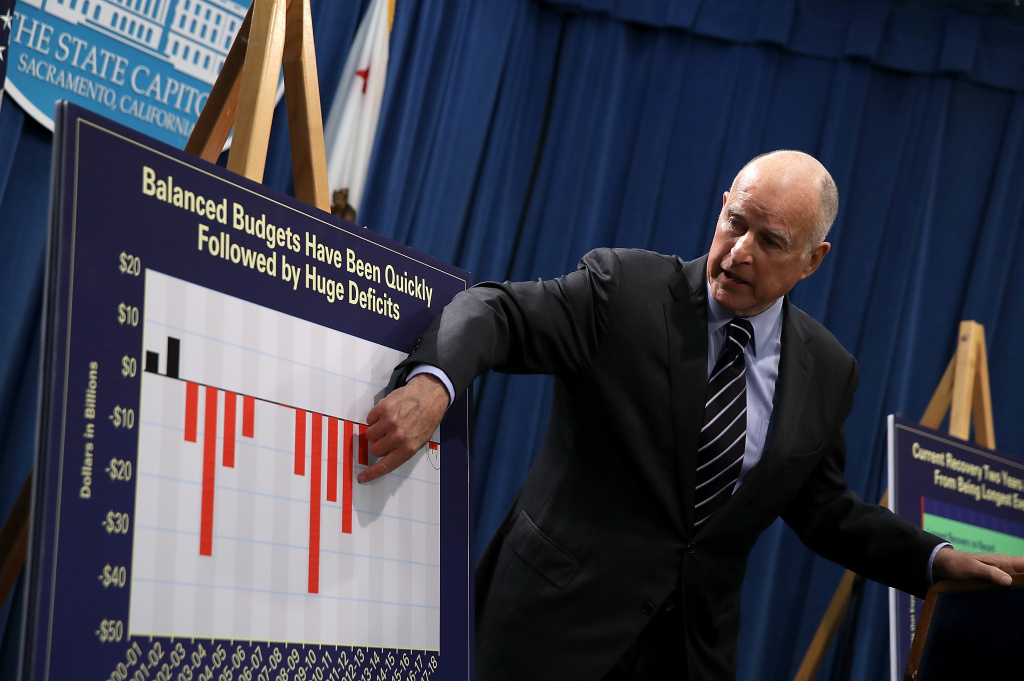 California Gov. Jerry Brown shows charts to reporters during a news conference where he revealed his revised California State budget on May 11, 2017 in Sacramento, California.