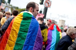 A Prop 8 opponent wears a gay pride flag on his back during a rally to celebrate the ruling to overturn Prop 8 August 4, 2010 in San Francisco.