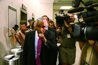 Followed by members of the press, U.S. Rep. Charles Rangel (D-NY) (L) leaves his office for a vote at the Capitol July 28, 2010 in Washington, DC.