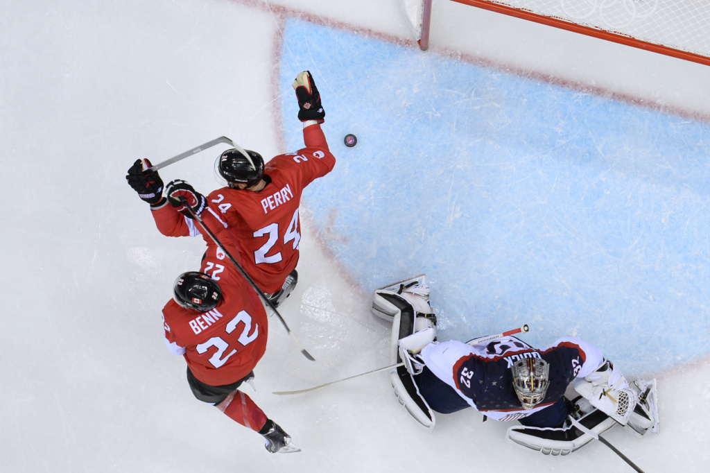 Canada's Jamie Benn (topL) and Canada's Corey Perry celebrate after scoring during the Men's Ice Hockey Semifinals USA vs Canada at the Bolshoy Ice Dome during the Sochi Winter Olympics on Feb. 21, 2014.
