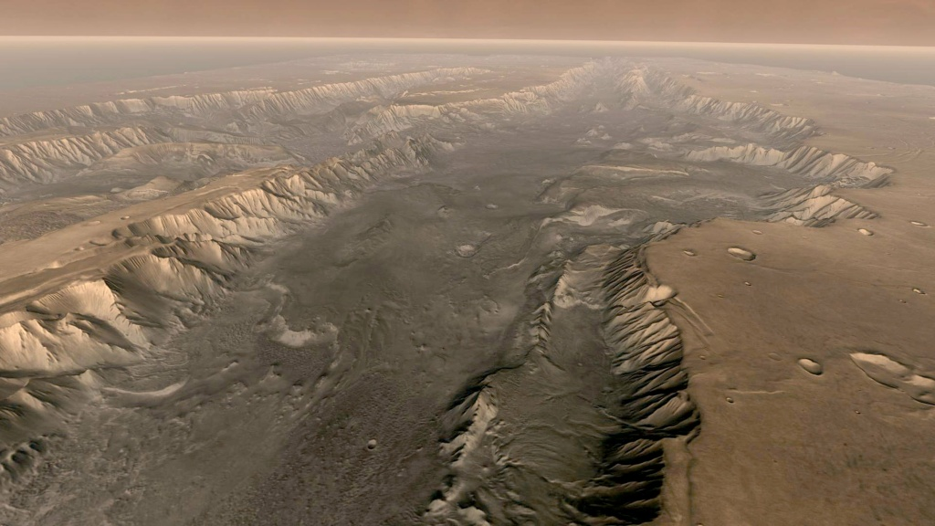 Mars' own Grand Canyon, Valles Marineris, is shown on the surface of the planet in this composite image made aboard NASA's Mars Odyssey spacecraft.