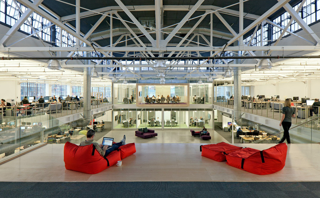 A view of the central area of Atlassian's office in San Francisco. The software company found that desks were used only 20 percent of the workday — half as much as conference rooms were used.