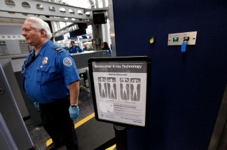 A sign at a Transportation Security Administration (TSA) checkpoint instructs passengers about the use of the full-body scanner.