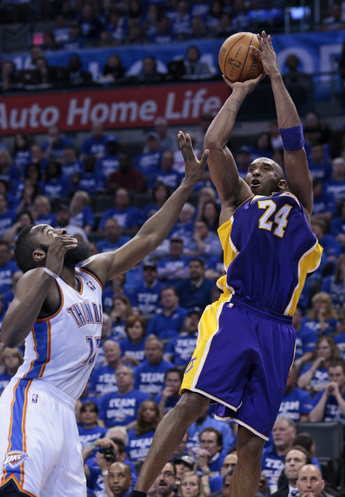 Kobe Bryant #24 of the Los Angeles Lakers shoots over James Harden #13 of the Oklahoma City Thunder in Game Two of the Western Conference Semifinals in the 2012 NBA Playoffs on May 16, 2012 at the Chesapeake Energy Arena in Oklahoma City, Oklahoma. The Thunder beat the Lakers 77-75.