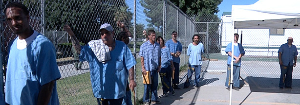 Prisoners at the California Institution for Men in Chino line up, waiting for medical appointments.