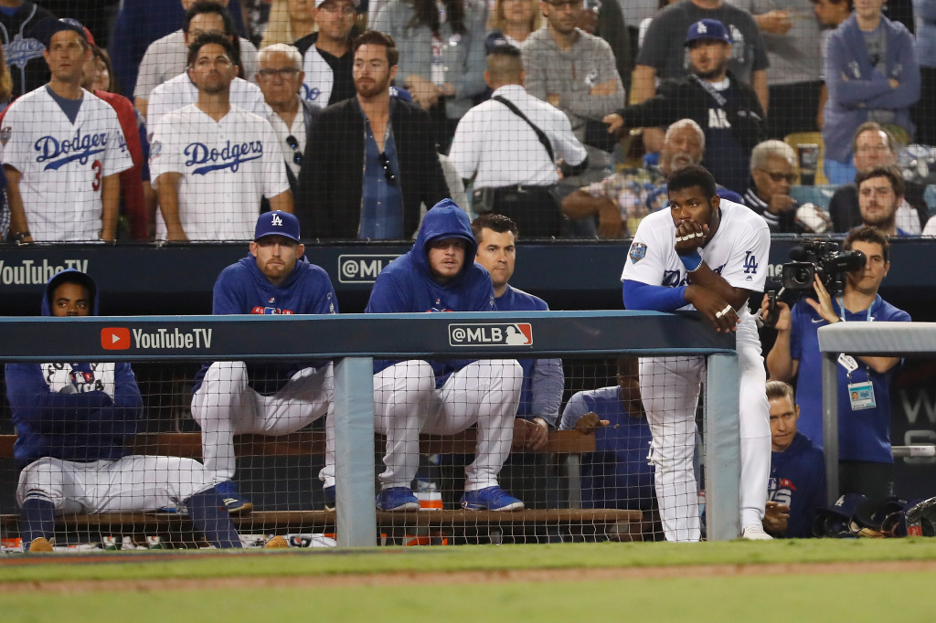 Yasiel Puig #66 of the Los Angeles Dodgers looks on from the dugout during the eighth inning against the Boston Red Sox in Game Five of the 2018 World Series at Dodger Stadium on October 28, 2018 in Los Angeles, California.