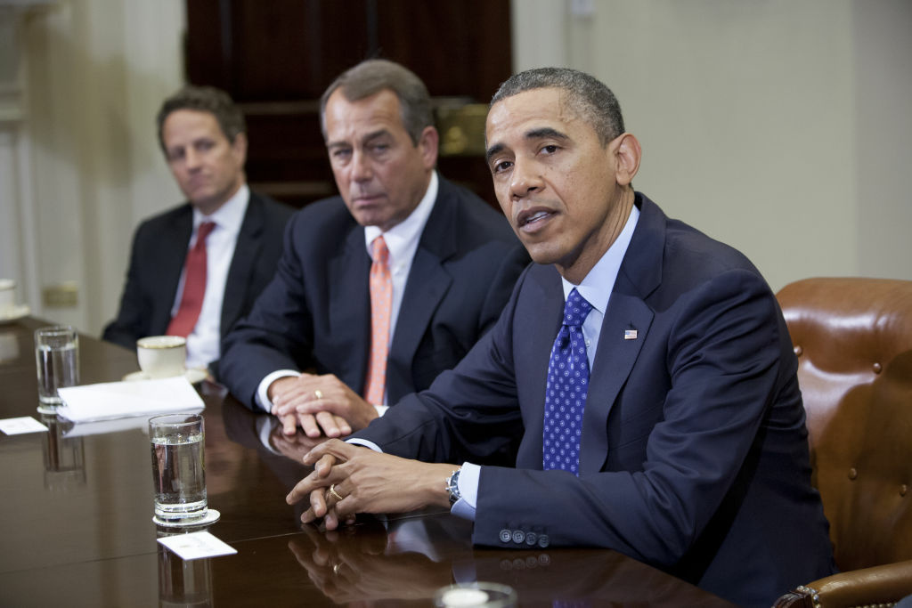 US President Barack Obama speaks before Speaker John Boehner (R-OH) Secretary of the Treasury Timothy Geithner (3rdR) and other cabinet members during a meeting on November 16, 2012 in Washington,D.C.