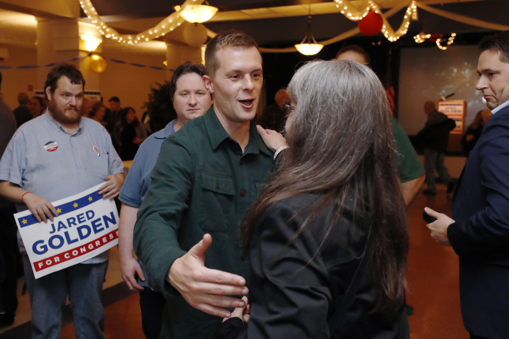 Democrat Jared Golden greets supporters as they wait on Election Day in Lewiston, Maine. Golden was declared the winner on Thursday as a result of the state's new ranked-choice voting system.