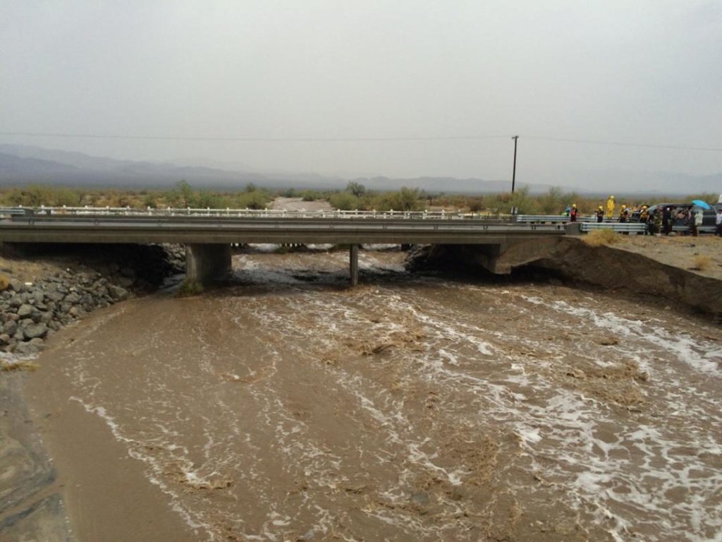 File: Waters rush under an the elevated portion of westbound Interstate 10.