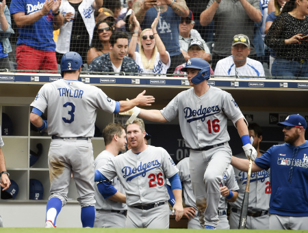 Chris Taylor #3 of the Los Angeles Dodgers is congratulated by Will Smith #16 after scoring during the the sixth inning of a baseball game.